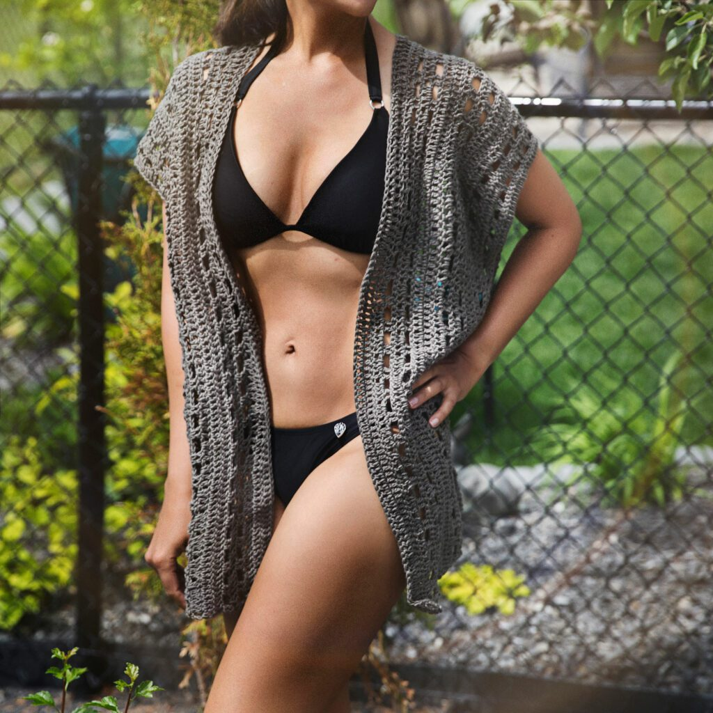 Crochet swimsuit cover up on lady with bikini